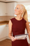 Woman Looking At Property Details In New Home Royalty Free Stock Photos