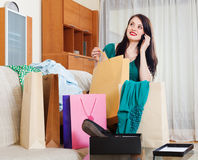 Woman looking purchases and speaking by mobile Stock Photos