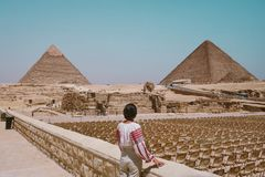 Woman Looking At Pyramids stock photo