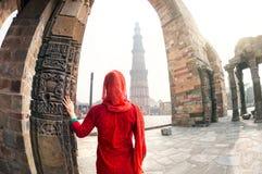 Woman looking at Qutub Minar Stock Photography