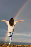 Woman looking at the rainbow Stock Photos