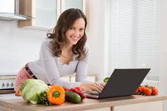 Woman Looking Recipe On Laptop Stock Photography
