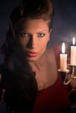 Woman looking on red candles in the fabulous night Royalty Free Stock Photo