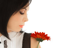 Woman looking on the red flower Stock Photos