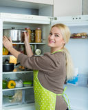 Woman looking in refrigerator Royalty Free Stock Photography