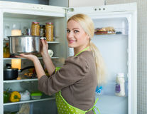 Woman looking in refrigerator Stock Images