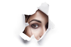 Woman Looking Through Ripped Paper Hole Stock Photos