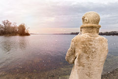 Woman Looking at the River during a Sad snowy Winter Day Stock Image