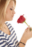 Woman looking at rose close Stock Photos