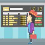 Woman looking at schedule board in the airport. Stock Images