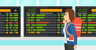 Woman looking at schedule board. A woman looking at schedule board at airport vector flat design illustration. Horizontal layout Royalty Free Stock Photos