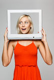 Woman looking through screen frame Royalty Free Stock Images
