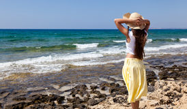 A woman is looking at the sea Stock Photo