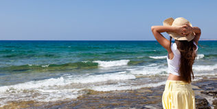 Woman is looking at the sea Royalty Free Stock Photography