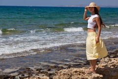 Woman is looking at the sea Royalty Free Stock Photos