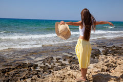 Woman is looking at the sea Stock Photo