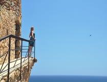 Woman looking at sea Stock Image