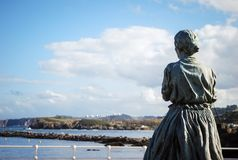 Woman looking sea in Asturias, Spain stock photography