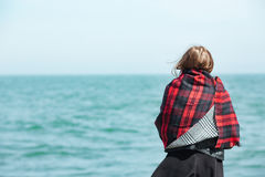 Woman looking on the sea Royalty Free Stock Image