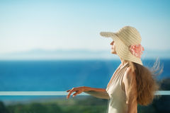 Woman looking on sea from balcony Stock Image