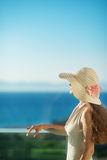 Woman looking on sea on balcony Stock Images