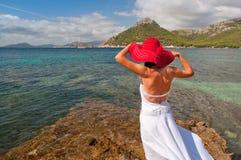 Woman looking at the sea Stock Image