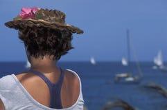 Woman looking at sea. Royalty Free Stock Images