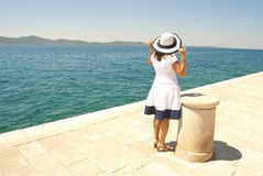 Woman looking in sea distance stock images
