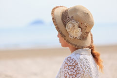 Woman looking into the sea Stock Photo
