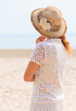 Woman looking into the sea Royalty Free Stock Image