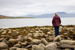 Woman looking at sea, Scotland Stock Photos