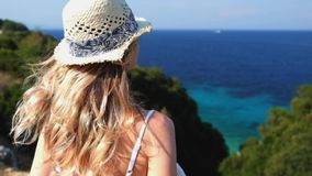 Woman looking at the sea standing at cliff stock video footage