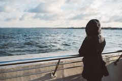 Woman looking at the sea at winter from pier. Royalty Free Stock Photos