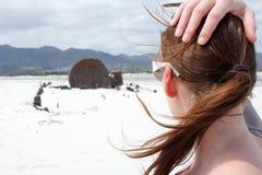Woman looking at Shipwreck Kakapo Stock Photo