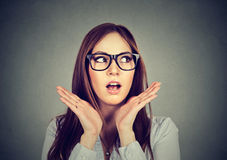 Woman looking shocked with hands up in air Stock Photography