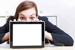 Woman looking shocked over tablet stock image