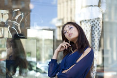 Woman looking at shop window boutique Stock Photo