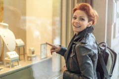 Woman looking in a shop window with jewelry Stock Image