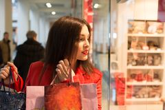 Woman looking at the shop window Royalty Free Stock Photography