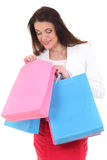 Woman looking into shopping bag Royalty Free Stock Images