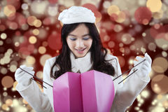 Woman looking at the shopping bag Stock Images