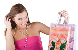 Woman looking at the shopping bags Royalty Free Stock Photography
