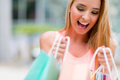 Woman looking into shopping bags Royalty Free Stock Photos
