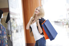 Woman looking at showcase Stock Images