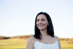 Woman looking at side relaxing on a meadow Stock Photos
