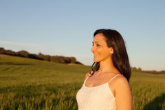 Woman looking at side relaxing on a meadow Royalty Free Stock Image
