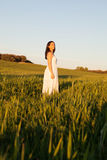 Woman looking at side relaxing on a meadow Stock Photo