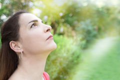 Woman looking the sky, wishing. Royalty Free Stock Photos