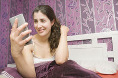 Woman looking smart phone Stock Photos