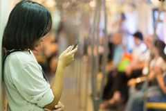 Woman looking smartphone screen royalty free stock photos